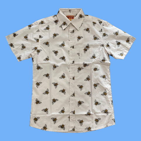 Pale beige, short-sleeved, button-up shirt with bee print.