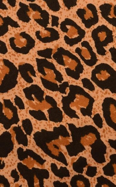 Image is a close up swatch of leopard print fabric