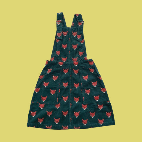 Dark green corduroy pinafore with fox head print.