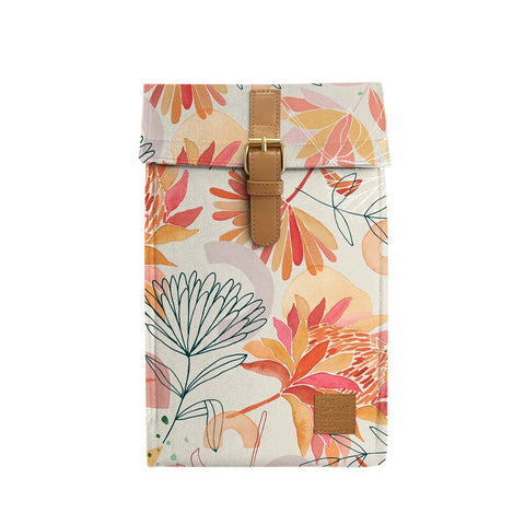 Image is of an insulated wine bag, with an illustrated watercolour-style protea print, and a faux leather buckle.