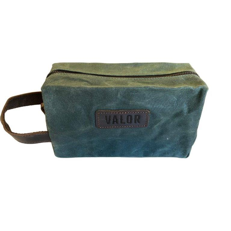 "Image is of a dark khaki, waxed canvas rectangular toiletries bag, with leather trim and a ""Valor"" logo on the front, on a white background."