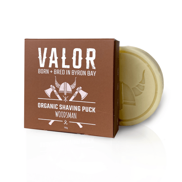 Image is of a brown cardboard Valor branded box, with a puck of Woodsman shaving soap.