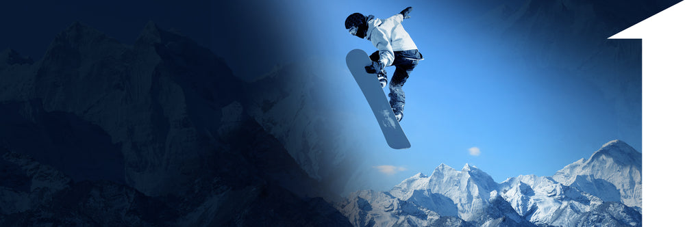 man on snowboard going over mountains | 1HUTCH