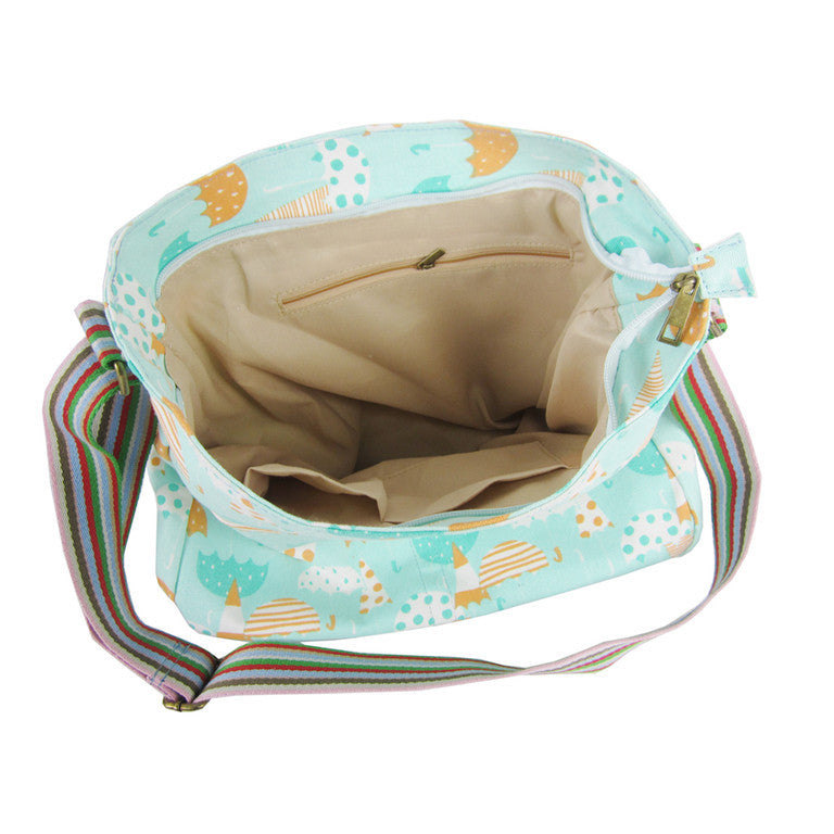 Umbrella print crossbody canvas bag in turquoise blue