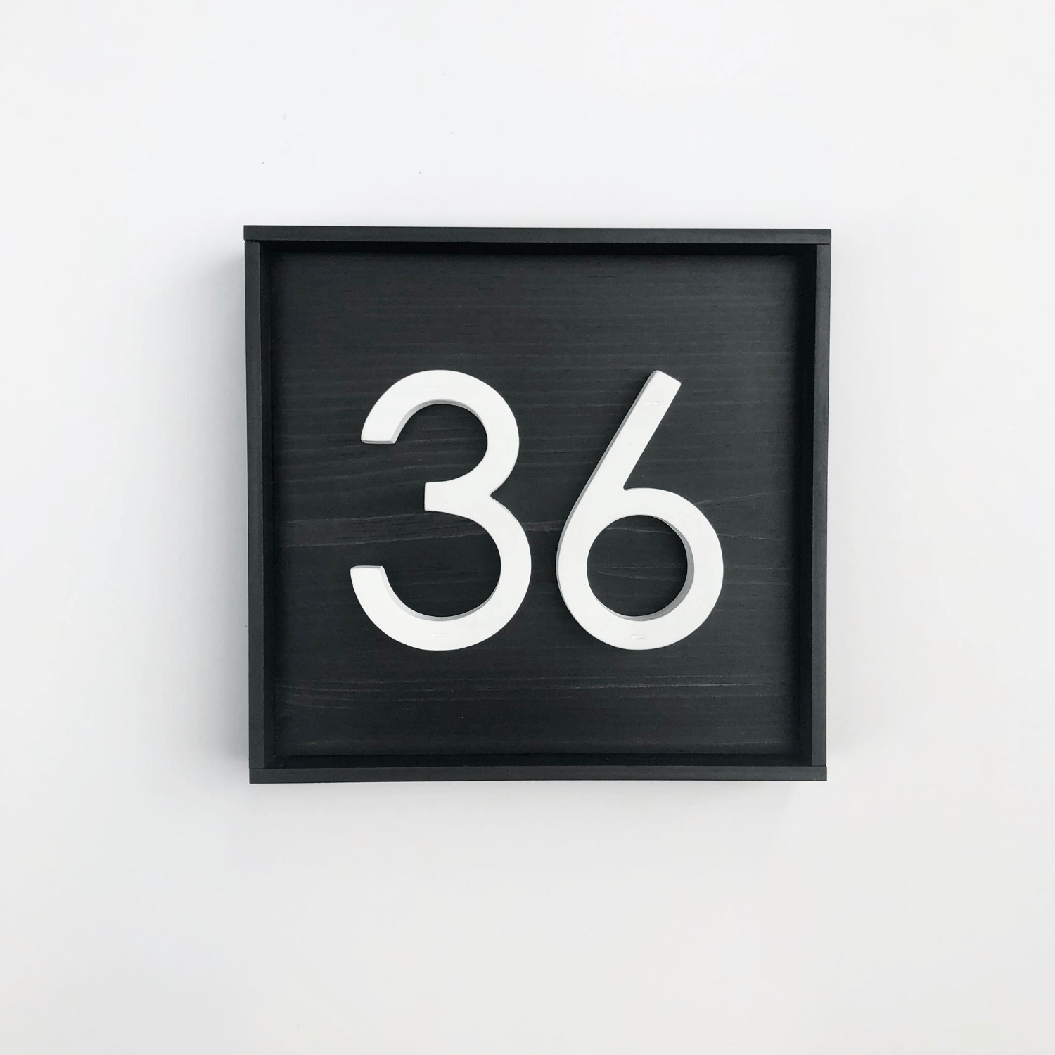 Square wood address sign with black base with 2 modern white PVC numbers