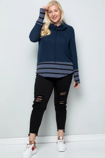 plus-sized woman wearing a color block navy shirt with striped