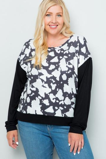 Woman in a cow print long-sleeved shirt
