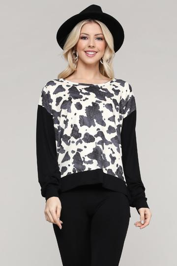 Woman in a cow print top