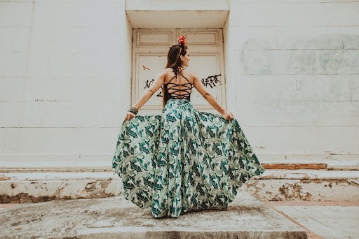 girl posing in a tropical skirt and top
