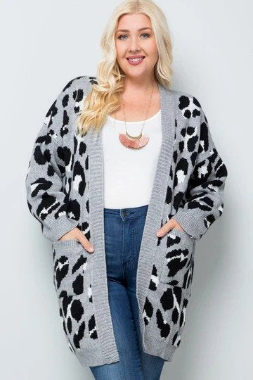 Woman wearing gray leopard print cardigan