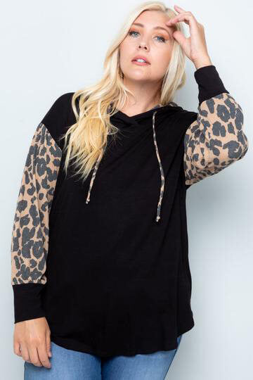 plus-sized woman wearing a leopard accented long-sleeve top