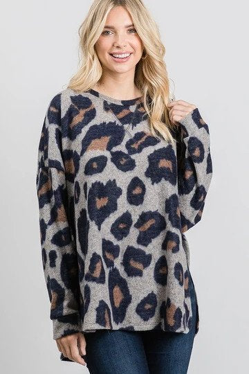 Woman wearing shirt with oversized animal print
