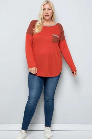 plus-sized woman wearing a red jersey styled shirt with a pocket