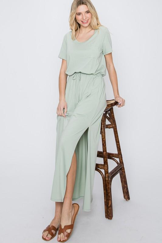 A woman wearing a sage colored maxi dress