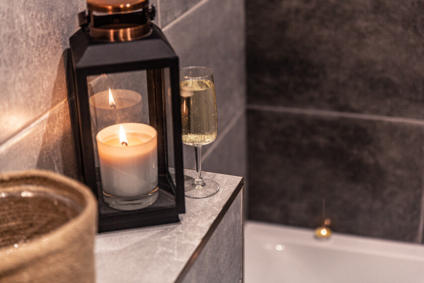 bathtub with candle and champagne