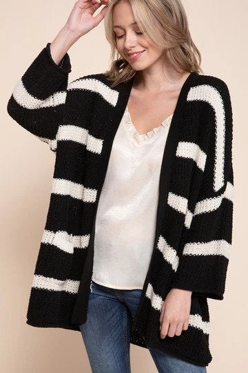 woman wearing a black and white striped cardigan