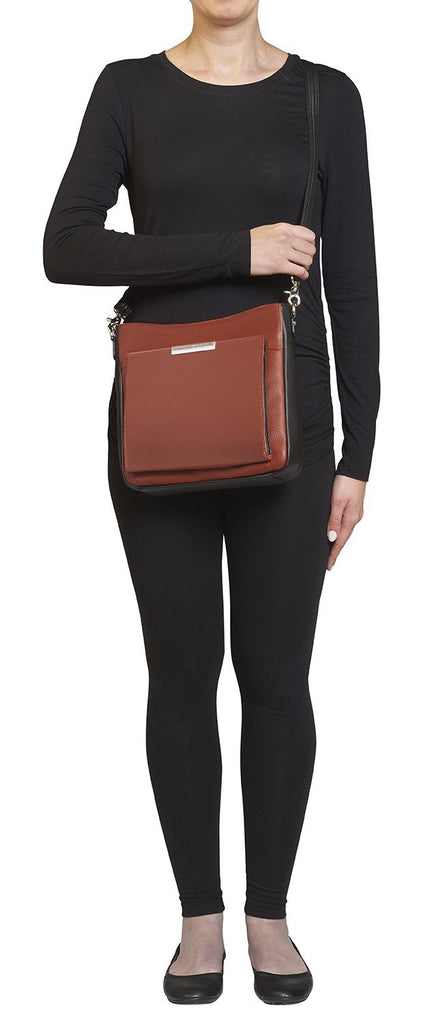 Concealed Carry Slim Crossbody Bag Cinnamon and Black Front on Model