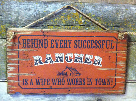 Old West Wooden Sign: Behind Every Rancher Is A Wife Who Lives In Town
