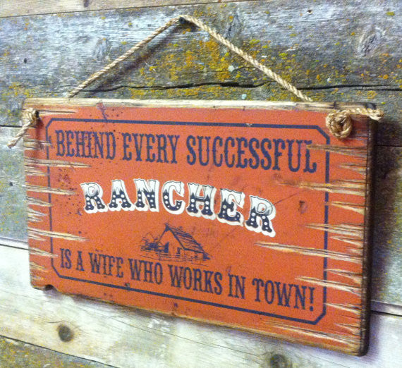 Old West Wooden Sign: Behind Every Rancher Is A Wife Who Lives In Town Right Side