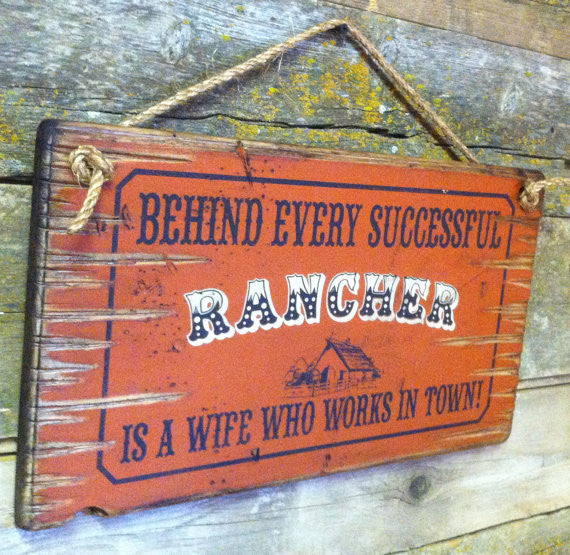 Old West Wooden Sign: Behind Every Rancher Is A Wife Who Lives In Town Left Side