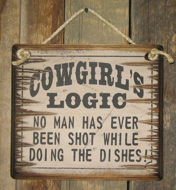 Western Wall Sign: Cowgirl's Logic No Man Has Ever Been Shot While Doing The Dishes!