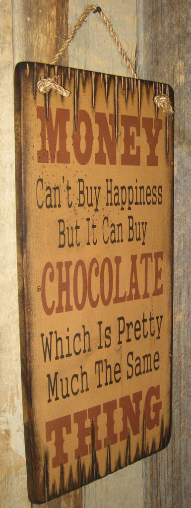 Western Wall Sign Money: Money Can't Buy Happiness But It Can Buy Chocolate Left View