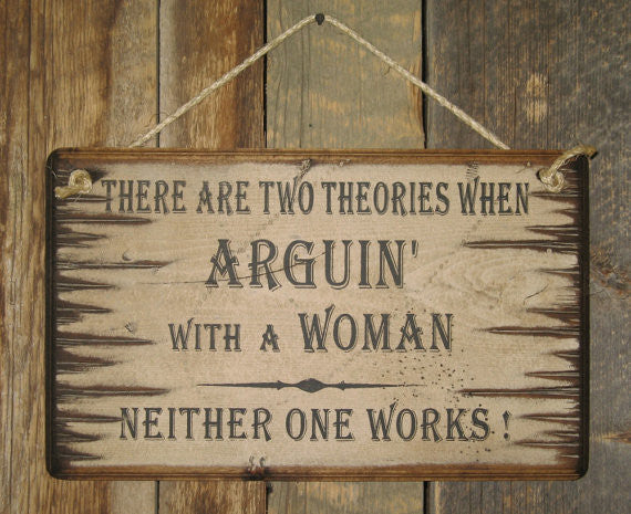 Western Wall Sign: There Are Two Theories For Arguin With A Woman