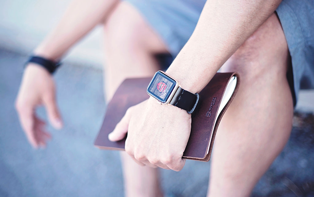 leather Apple watch band on person sitting