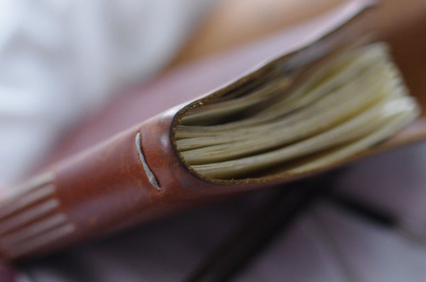 a hand sewn leather journal