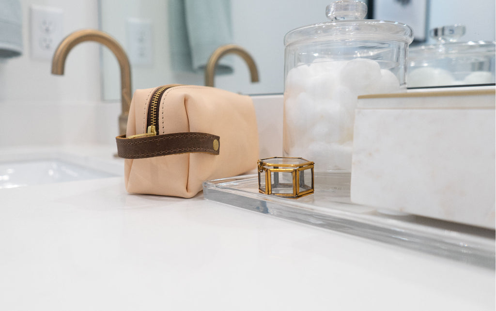 leather pouch for toiletries on a bathroom counter
