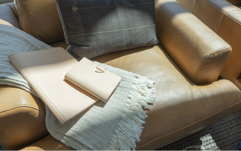 leather journals on a chair in morning sunlight