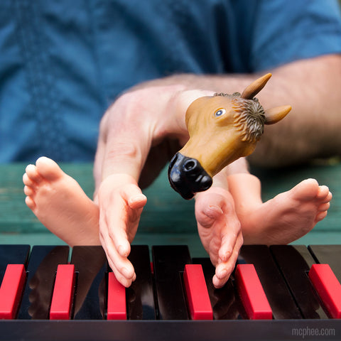 Horse human hand hybrid playing keyboard