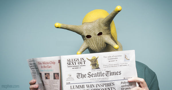 slug reading a newspaper seattle times