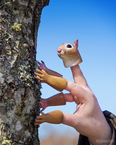 Handisquirrel climbing tree with blue sky