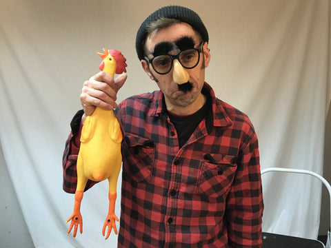 Behind the scenes shot of Alastair with Rubber Chicken and Groucho Glasses