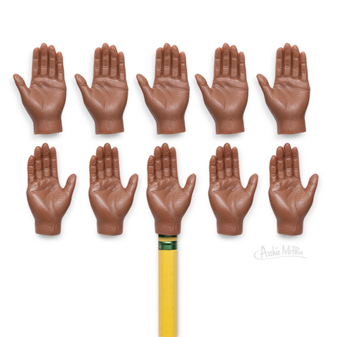 tiny hands in dark skin tone brown