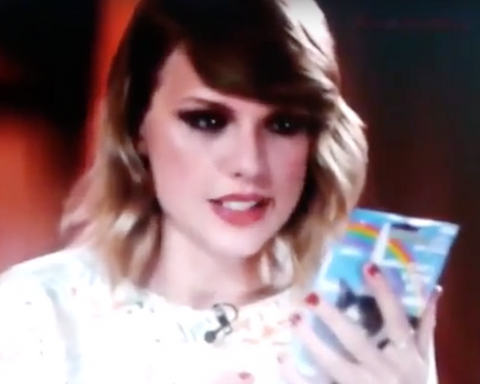 Taylor Swift studies Inflatable Unicorn Horn to see if it's real