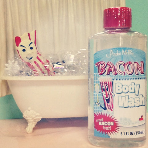 Mr. Bacon is a bath tub with suds bacon body wash in front