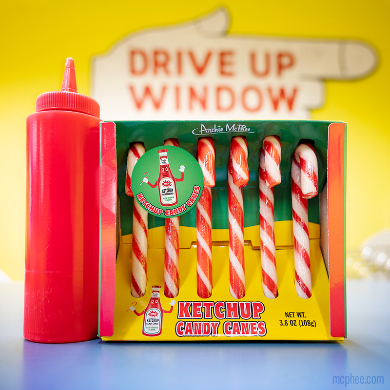 Ketchup Candy Canes in front of drive up window sign.