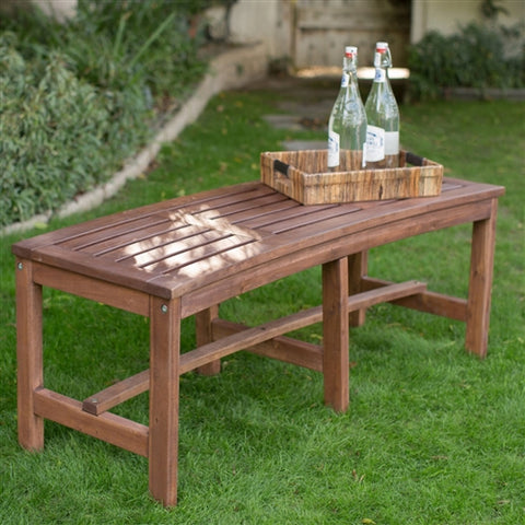 backless curved wood bench for fire pit area or tree