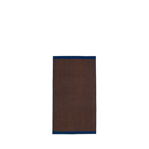 Handwoven Loop rug in blue, brown and blue made of 100% Wool.