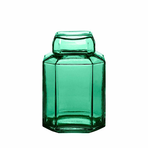 Packshot of mouth blown glass container in the color green.
