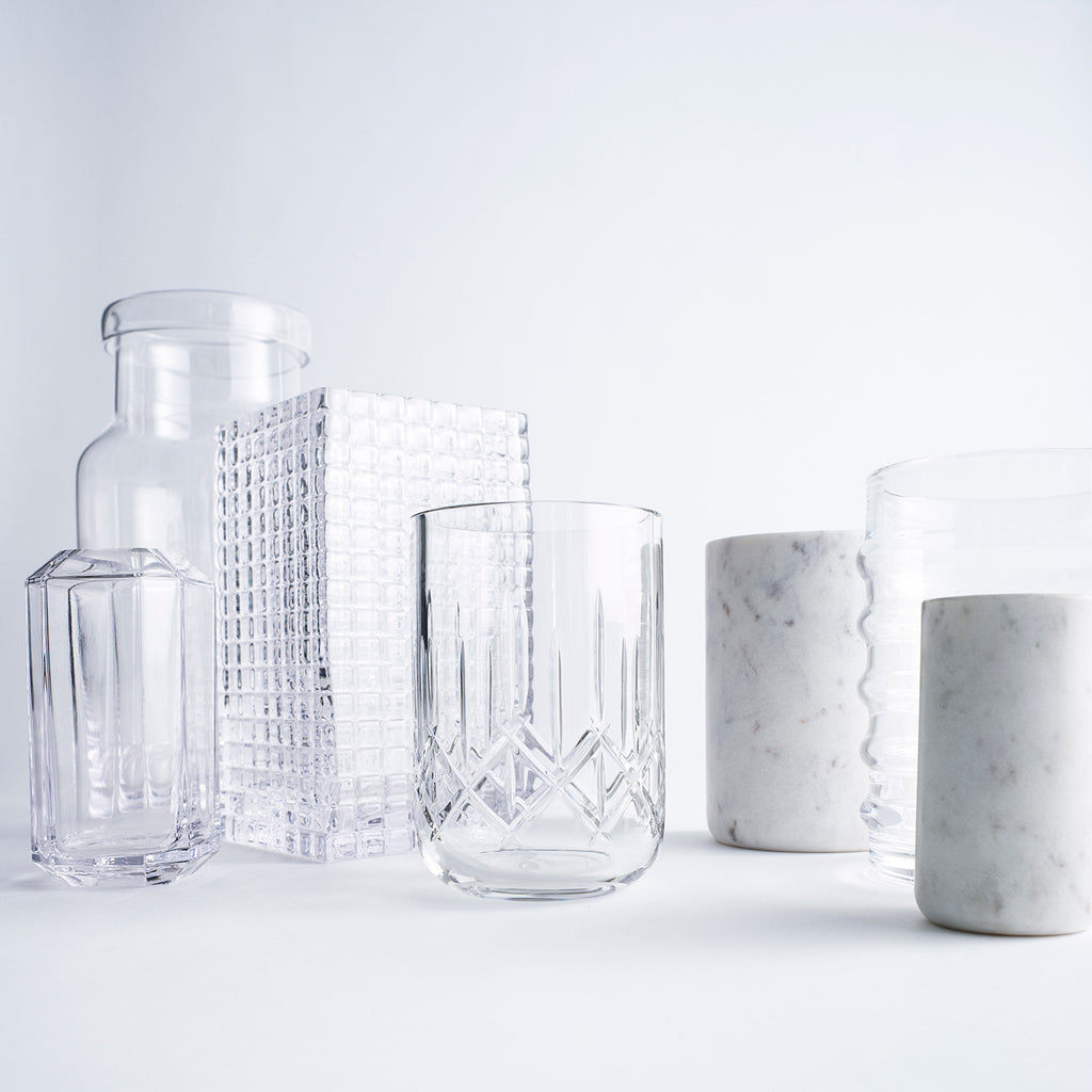 Glass vases, crystal glass vases and white marble vases on a white backdrop.