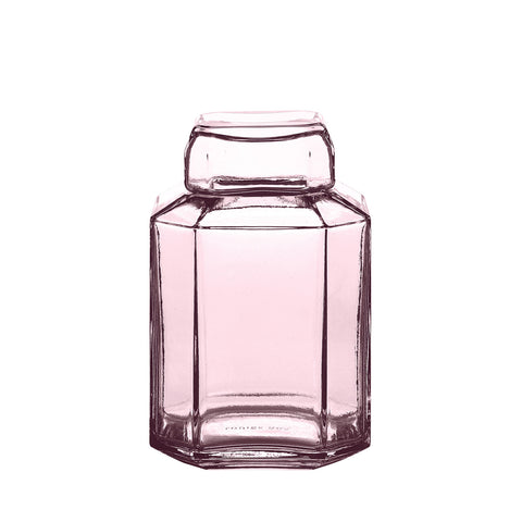 Packshot of mouth blown glass container in the color rose.