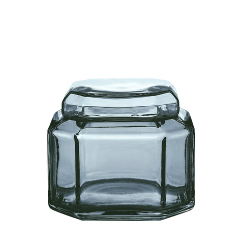 Packshot of mouth blown small glass container in the color blue.