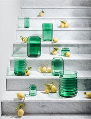 creative stairway with green mouth blown glass vases and decorative lemons