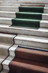 Handwoven Loop rugs on a staircase.