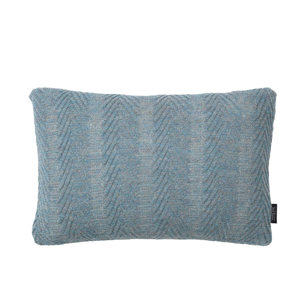 Rectangular knitted baby alpaca wool cushion in antique blue.
