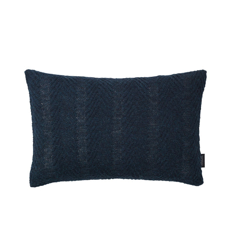 Rectangular knitted baby alpaca wool cushion in blue.