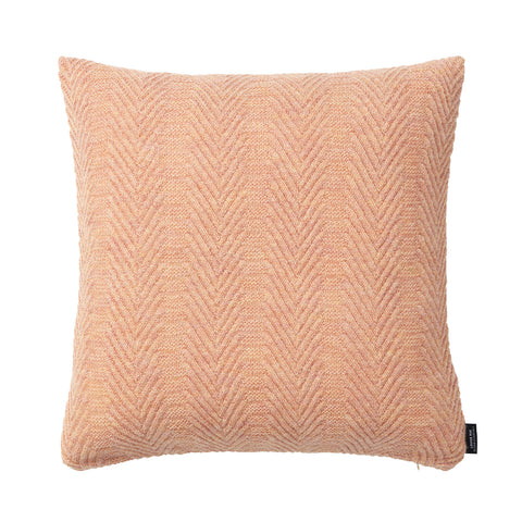 Square knitted baby alpaca wool cushion in pearl rose.